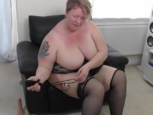 This fat mature lady has a sweet ass. She strips and shows off her fat curves...