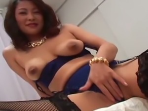 Japanese MILF Marie Sugimoto exposes and plays with her big boobs
