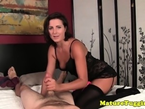 Handjob milf in stockings tugging hard cock