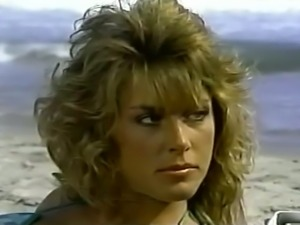 Mesmerizing bronze skin classic blonde babe on the beach