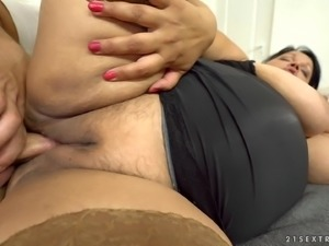 Bubi is a mature brunette with massive tits in need of a shag