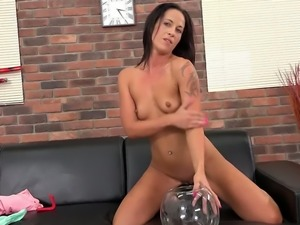 Sexy looking tattooed brunette Vanessa Twain plays with tits and pisses