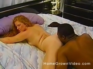 Retro curly haired girl getting fucked hard by a black guy on a bed