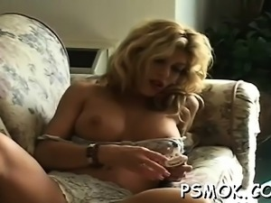 Mature whore blows a chap whilst smoking a cigarette