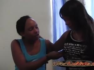 Ebony lesbians fingering each other