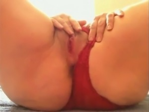 Check out big racked lady in red panties masturbating her own pussy