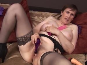 Classy mature Allison in stockings masturbating using toy