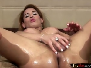 Oiled tranny stroking her dick and making us very horny
