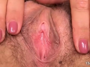 Tiny brunette gaping her hairy pussy