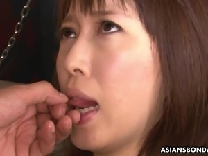 Restrained Asian redhead chokes and drools on the hard cock