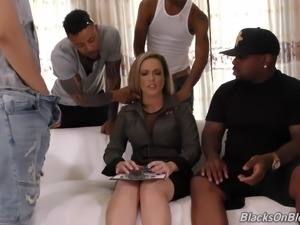 Hot chick Carmen Valentina enjoys a bunch of black dongs
