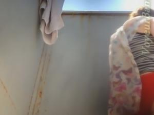 Lovely white amateur milf in the beach cabin filmed on spycam