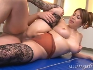 An Asian MILF gets oiled up and fucked nice and hard