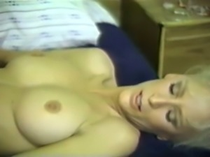Busty brunette and hot blonde babe on the bed in softcore lesbian action