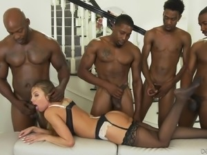 Britney Amber enjoys being a part of an interracial gangbang fuck