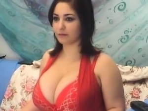 Milf in red lingerie shows her huge boobs