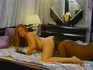 Vintage interracial sex between a mature redhead and a black guy