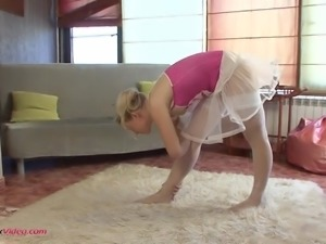 This chick is one flexible ballerina who likes to show off her small tits
