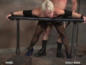 First, blonde milf, Helena Locke, was placed in a special bondage device and...