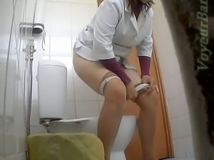 Lovely and sexy doctor pulls down her pantyhose and pisses