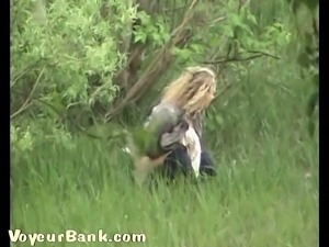 Blonde young chick goes in the woods to piss and gets filmed on cam