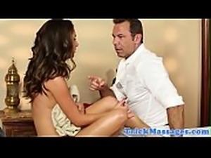 Deepthroating babe working on masseurs cock