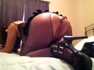 Dirty and filthy wife anal masturbating in kinky outfit