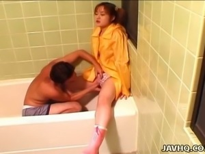 Mana Anzai lets her lover stimulate her twat with her vibrator in the bathroom
