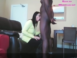 This lewd chick is sucking this dude's big black cock like a skilled slut