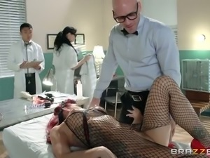 Tattooed harlot in fishnet stockings gives great blowjob to bald headed doctor