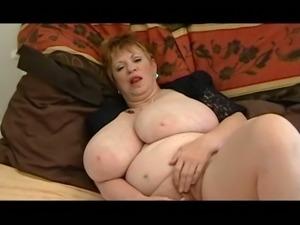 Lewd light haired mature BBW with big saggy tits masturbates herself