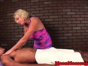 Mature masseuse withholds clients climax