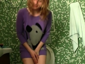 My Russian girlfriend Olesya is pissing in the toilet room