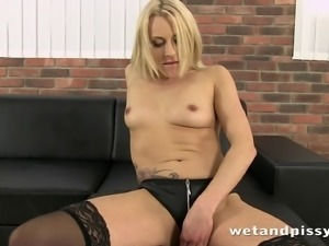 Tattooed blonde solo model with a masturbation fetish pissing in a container