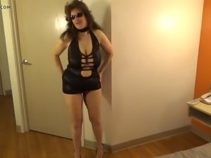 tinja stretches a black mini dress