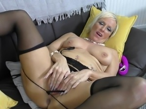 short haired granny fingers her pussy
