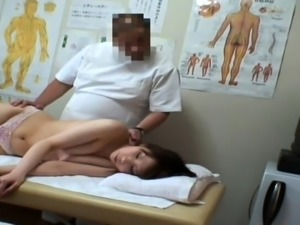 Charming Japanese girl has a masseur fingering her pussy