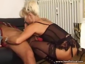 I am Pierced MILF with pussy piercings in black stockings