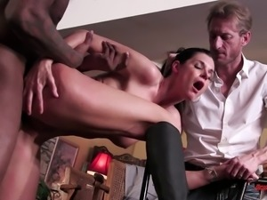 A cuckolded husband watches his wife get railed by a black guy