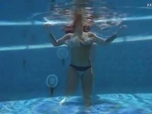 Beautiful mermaid Puzan Bruhova swims and kinda strips underwater