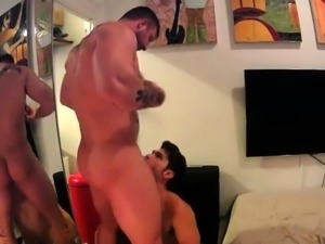 Muscled amateur hunk has a horny boy deepthroating his cock
