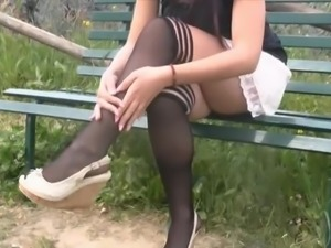 Stocking-clad brunette showing off her stunning legs and feet