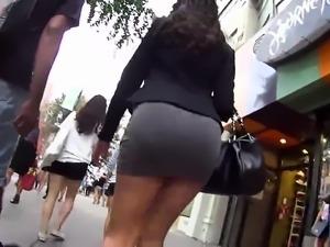 Street voyeur follows a sexy brunette with a sensational ass