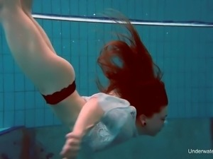 Nice chick Katrin Bulbul swims and flashes her pierced hard nipples
