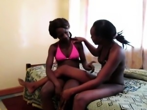 Naughty lesbians from Africa remove bikinis and start