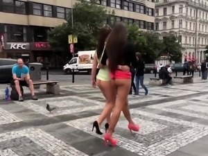 Two attractive European babes expose themselves in public