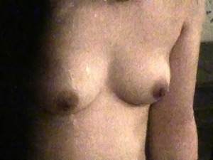 Sweet Japanese girl takes a bath and exposes her lovely tits