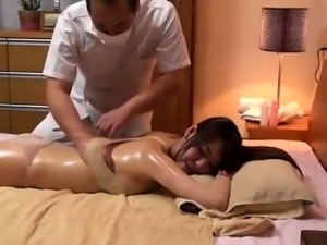 Stacked Oriental beauty has a masseur banging her hairy cunt