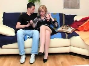 Bushy blonde Nora in nice panties gives blowjob