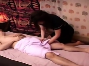 Stacked Asian masseuse buries a cock inside her needy snatch